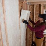 white fiberglass batt insulation installed in a wall cavity